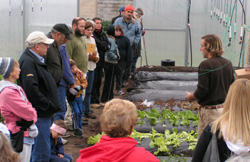 Jimmy Spencer, of Pond Hill Farm, near Harbor Springs, explains hoophouse management during a Fall, 2009 tour.