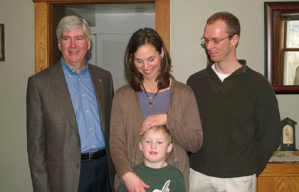Governor Rick Snyder liked what he saw when he visited Elizabeth, Chris and young Matt Kushman's Traverse City home after it received an extensive efficiency retrofit through the city's TC Saves program.