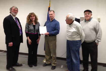From left: MPSC's Paul Proudfoot and Julie Baldwin accepted an 1,800-signature petition from Sierra Club's Brad van Guilder and signers Bob Wasserman and John Ford, owner of a solar power system, after the Apr. 8 Solar Work Group session. The petition urges quick action setting strong pro-solar policies. (Photo: Anne Woiwode)